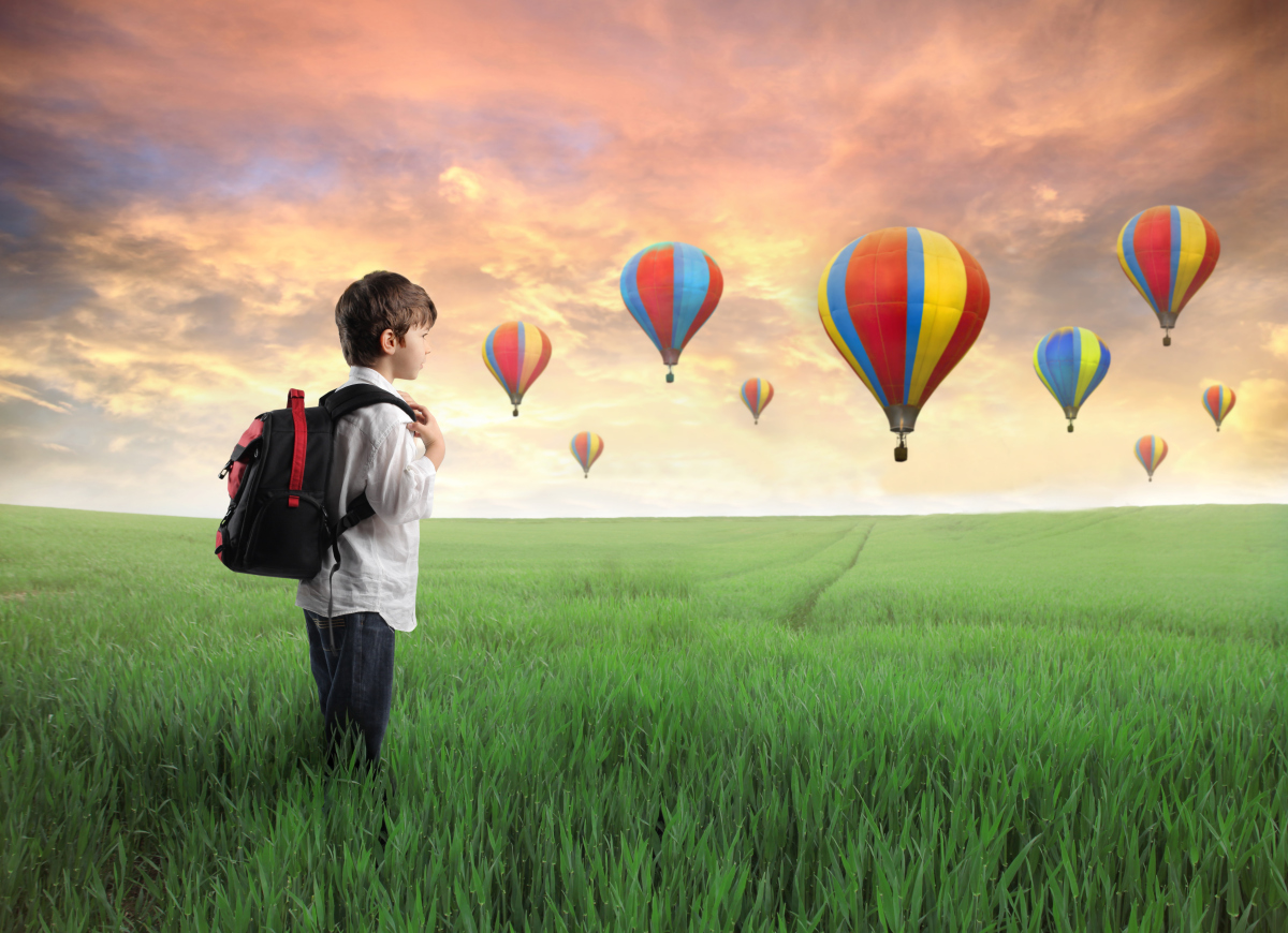 kid-in-a-meadow-of-hot-air-balloons