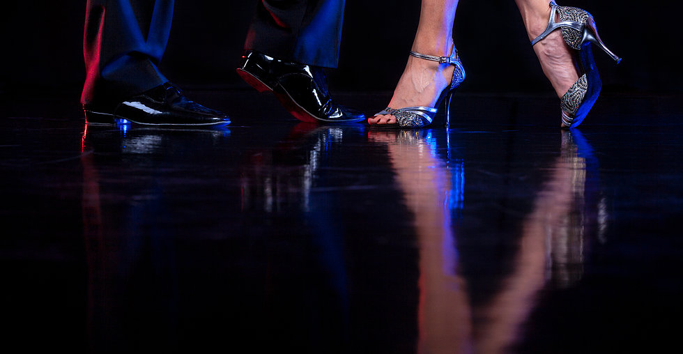 http://www.dreamstime.com/stock-image-couple-professional-latin-dancers-close-up-dancer-s-feet-dramatic-light-image29922891